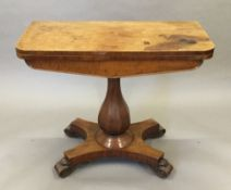 A Victorian mahogany card table, with baluster pedestal and quadripartite plinth base. 91 cm wide.