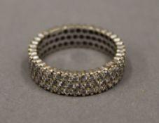 A 14 K gold full eternity ring (3.