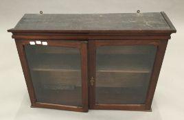 A 19th century mahogany glazed hanging cabinet