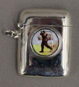 A silver vesta depicting a golfer