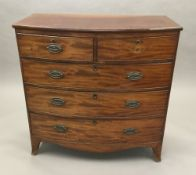 A 19th century mahogany bow front chest of drawers, with two short drawers over two long drawers.