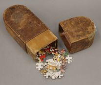 A 19th century leather box containing a jigsaw puzzle