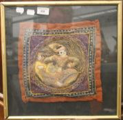 A framed Eastern tapestry depicting the figure of a deity