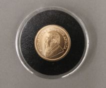 A quarter uncirculated Krugerrand,