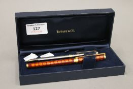 A French Dupont Laque De Chine ballpoint pen, together with a Tiffany & Co pencil,