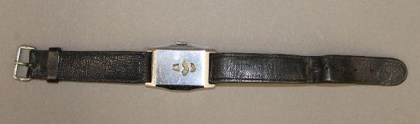 A Deco gentleman's jump hour wristwatch