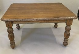 A 19th century carved oak dining table, with fixed top. 137 x 105 cm, 73 cm high.