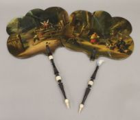 A pair of 19th century painted hand screens, one decorated with figures before a house,