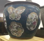 A large modern Chinese porcelain fish bowl