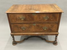 An 18th century style walnut chest of drawers on stand