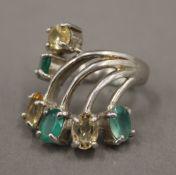 A silver multi-stone ring