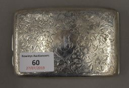 An early 20th century engraved silver cigarette case of curved form (4.