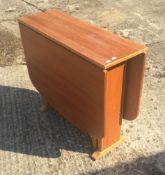 A drop flap table