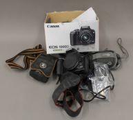 A quantity of 35mm camera equipment comprising: Canon EOS 1000D and lens and digital cameras