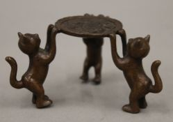 A small Japanese bronze group of cats