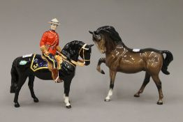 A Beswick model of a Mountie on horseback and a Beswick brown stallion