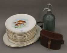 A French ceramic fish decorated service by Gien, comprising: sixteen plates and a pair of platters,