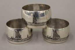 A set of three Egyptian niello decorated white metal napkin rings
