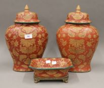 A pair of Oriental style lidded vases,
