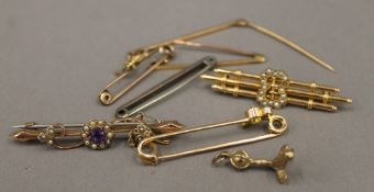 A collection of six Victorian/Edwardian 9 ct gold bar brooches, a 9 ct gold and silver bar brooch,