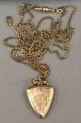 An Edwardian yellow metal photo locket on a muff chain