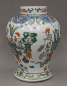 A Chinese famille verte vase decorated with floral and precious objects