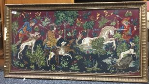 A framed tapestry wall hanging,