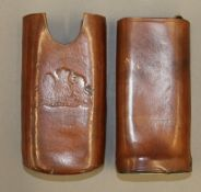 A leather cigar case,
