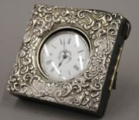 An Edwardian silver mounted leather pocket watch case and silver cased watch
