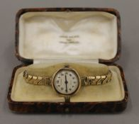 A 9 ct gold cased lady's wristwatch, the dial signed Walker, the movement Swiss,