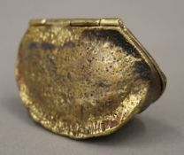 A brass vesta formed as a Brazil nut