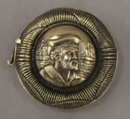 A brass vesta formed as a life ring centred with sailor portraits