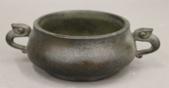 A Chinese bronze censer with elephant form handles