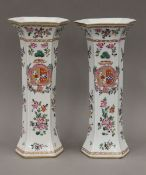 A pair of 19th century Samson porcelain famille rose armorial vases in the Chinese taste