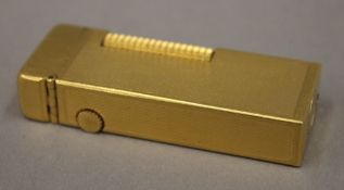 A gold plated Dunhill lighter