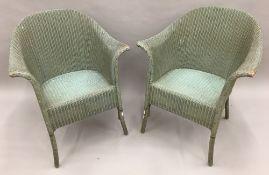 A pair of Lloyd Loom armchairs