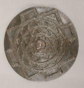 A cast bronze Chakra disc