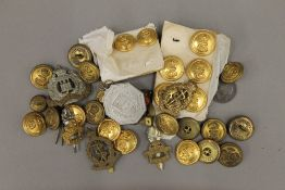 A quantity of military cap badges,