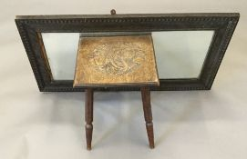 A low stool with carved seat worked with poppies; together with an oak framed mirror.