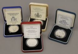 Four Royal Mint United Kingdom silver proof Royal Commemorative Crowns,