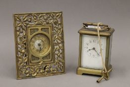 A brass cased carriage clock and a brass desk clock