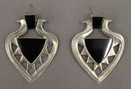 A pair of pendant silver earrings