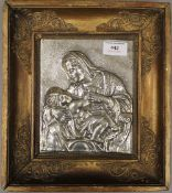 A 19th century silvered metal relief plaque depicting Madonna and Child,