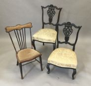 Two carved salon chairs,