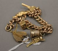 A 9 ct gold charm bracelet and charms (28.