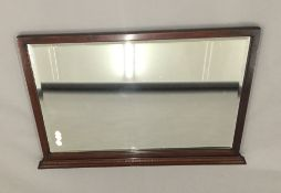 An Edwardian mahogany framed overmantle mirror