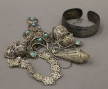 A quantity of white metal filigree jewellery,