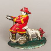An American cast iron doorstop, modelled as a fireman and his dog. 19 cm high.
