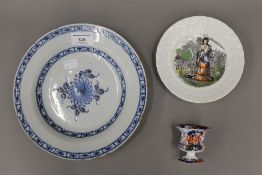 An 18th century blue and white Delft pottery plate,
