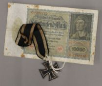 A German WWI iron cross and a German 1920s 10,